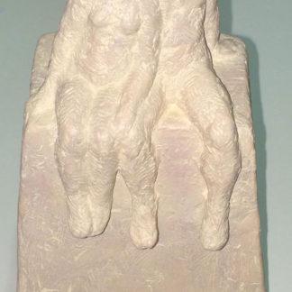 Two figures sitting, jesmonite and earth pigmants.