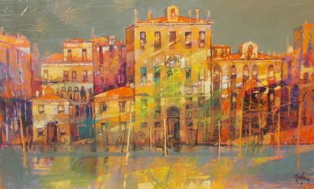 Venetian canal with golden buildings