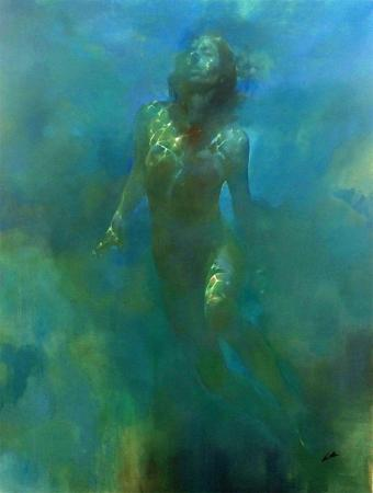 Female nude swimming upwards under water
