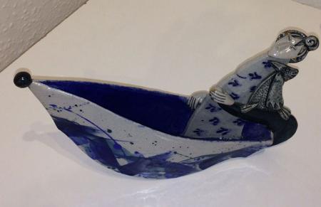 Female figure in a boat, ceramic
