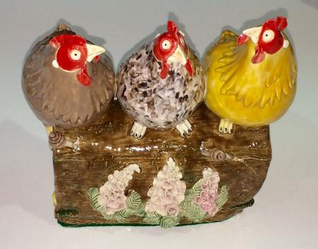 3 colourful hens on a log, ceramic.