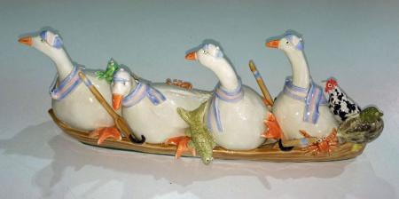 4 geese rowing, ceramic.